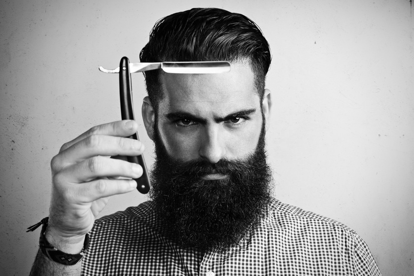 Portrait of brutal man with straight razor